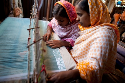 Women work a loom in Bangladesh. ©  CARE / Josh Estey 2008