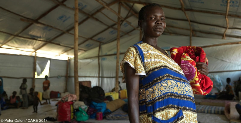 Esther, 21 and pregnant, walked for two weeks to Uganda after an attack on her village in South Sudan
