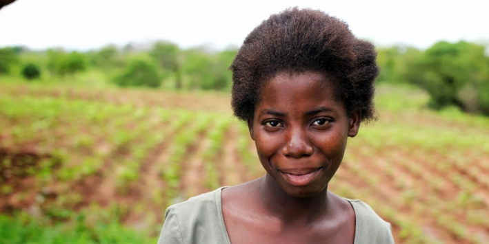 A young female farmer from Malawi. Investing in female smallholders can make a massive difference to food security, yet this issue was skirted over at the the Committee on World Food Security. © CARE