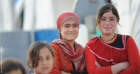 Young women who fled violence in their home area to take refuge in a camp for internally displaced people in the Kurdistan Region of northern Iraq