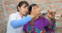 Minakshi Neupane helping an adolescent girl during Photovoice – an innovative tool used for the evaluation of Tipping Point Phase 1