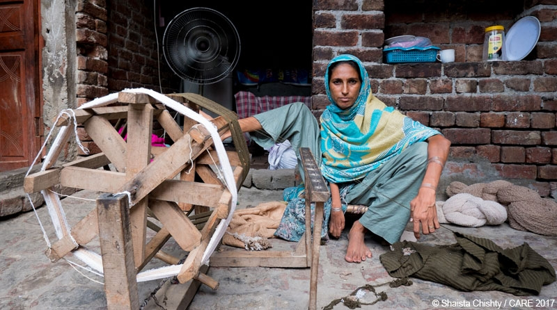 Allah Rakhi, a seamstress from Pakistan and recipient of a Lendwithcare loan