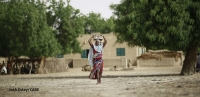 A women carries a VSLA safe, Mali