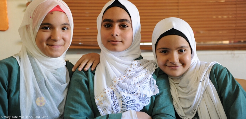 Syrian sisters Haneen, 14, (left) and Sidra, 13, (right) join friend Reem, 14, (centre) in a peer to peer support group for Syrian and Jordanian teens at a CARE community centre in Irbid, Jordan.