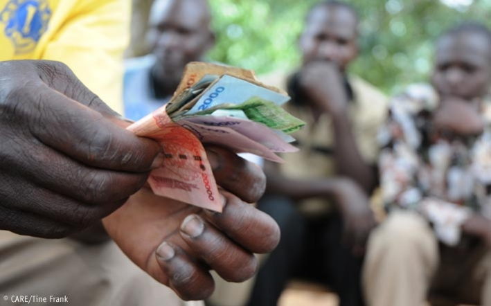 Counting money at a VSLA meeting in Uganda