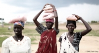 Women carrying seeds distributed by CARE to households in Jonglei, one of the areas most affected by the conflict in South Sudan